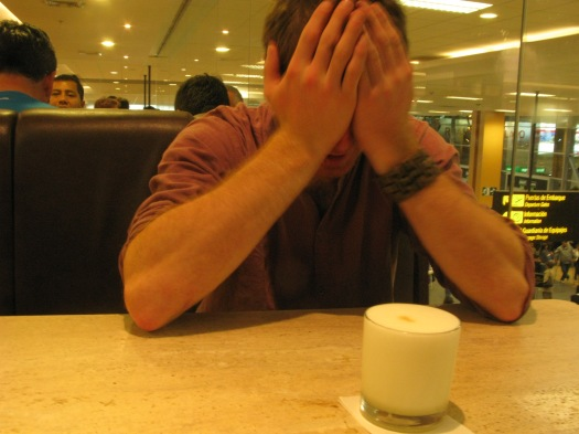 Brian (in sadness and shock) with his last Pisco Sour at the airport. Our final hours in South America.
